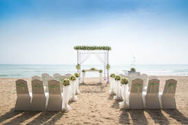 Picture of beach wedding chair rental set up in Miami, FL